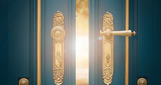 antique ornate gold door handle closeup on blue wooden door