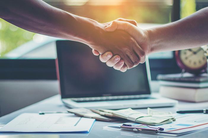 business partners handshaking after business success negotiation