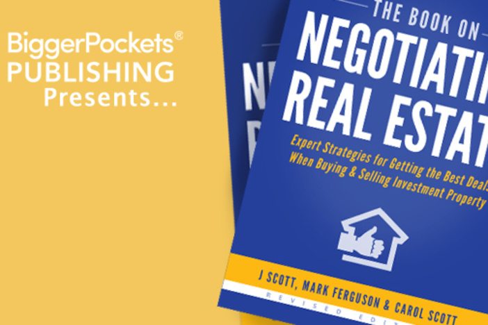 two stacked, fanned copies of The Book on Negotiating Real Estate on a yellow background