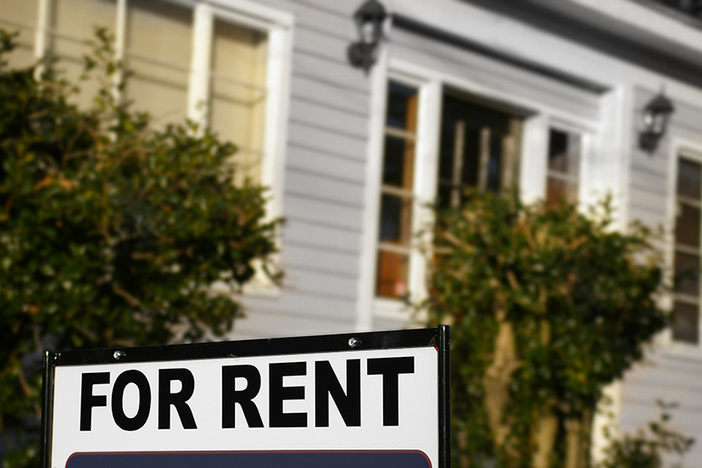 """House with """"For Rent"""" sign in front"""