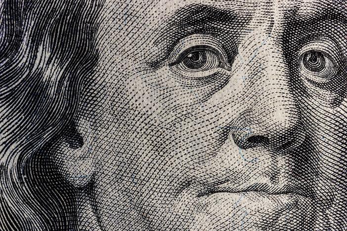 Closeup of Ben Franklin on a one hundred dollar bill